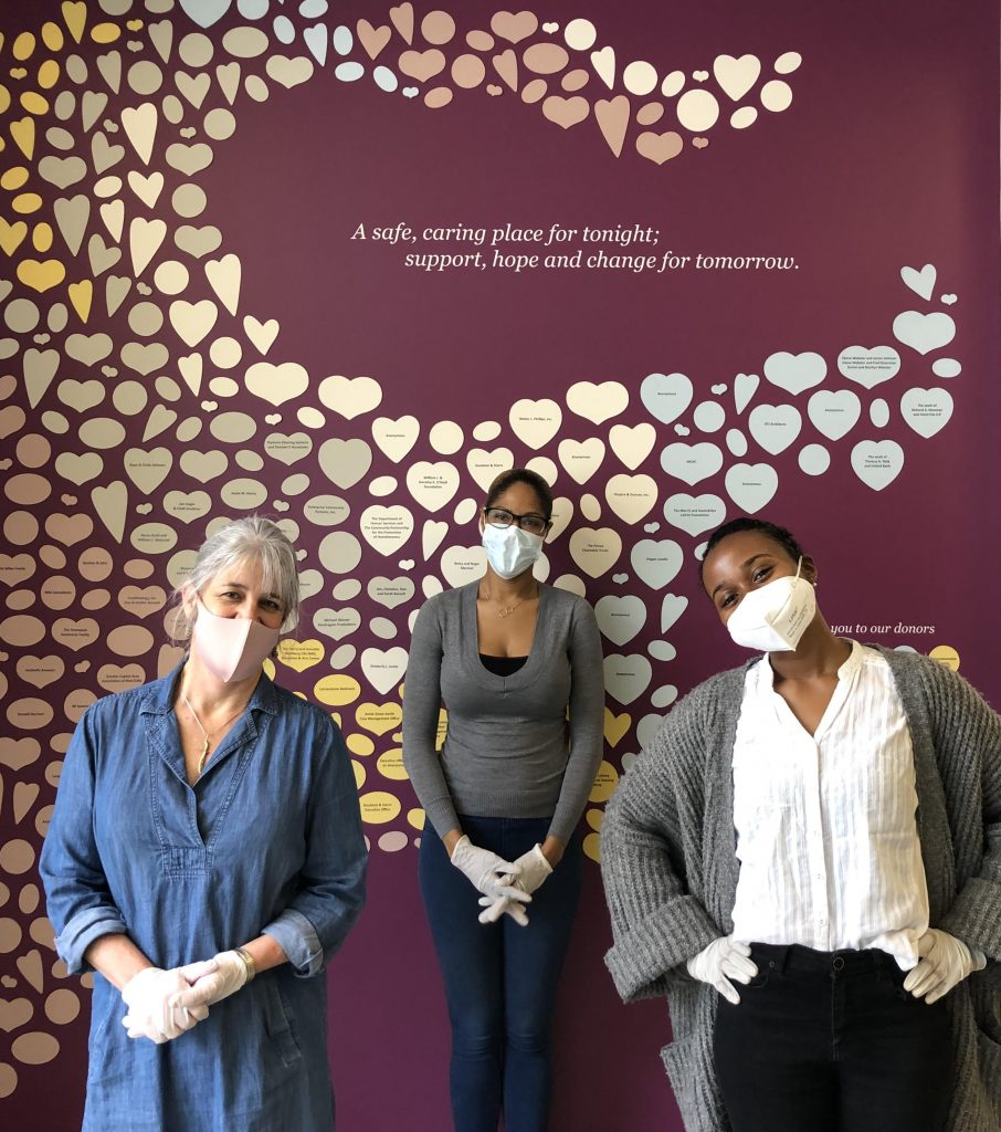 image of 3 women wearing masks in front of a purple wall at Calvary Women's Services